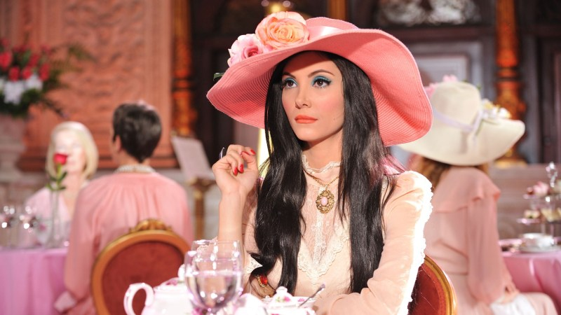 elaine from the love witch in a pink hat